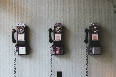 vintage-telephones-hanging-on-floor.jpg