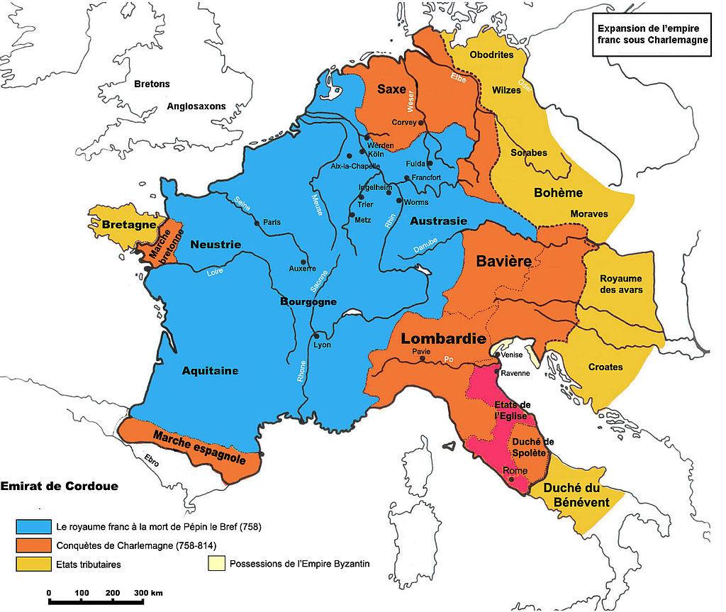 カール時代(768年~811年)のフランク王国(青がカール即位時のフランク王国、赤橙がカールの獲得領、黄橙がカールの勢力範囲、濃赤はローマ教皇領)