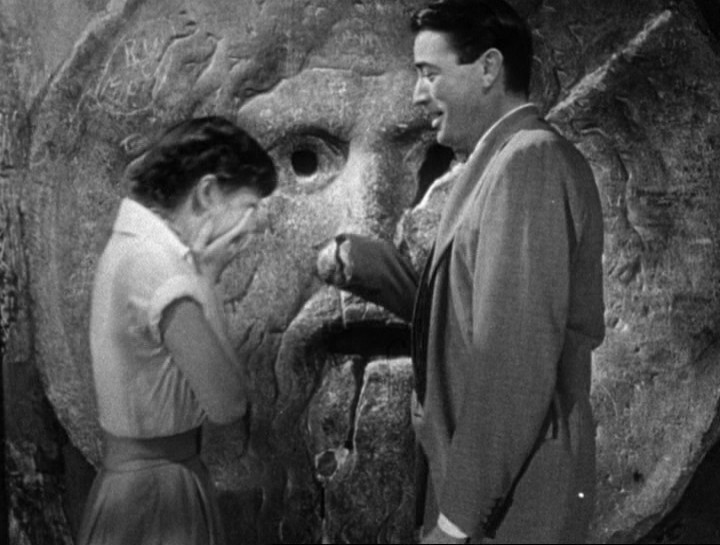 Audrey_Hepburn_and_Gregory_Peck_at_the_Mouth_of_Truth_Roman_Holiday_trailer.jpg