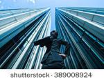 stock-photo-businessman-looking-up-at-the-high-building-low-angle-389008924.jpg