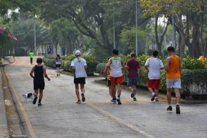 Runners and Cat, Lumpini Park, Bangkok Thailand